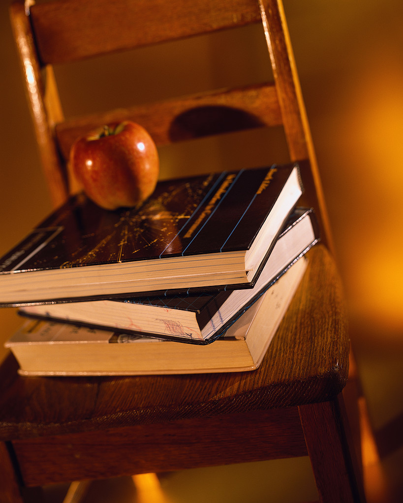 Apple and Textbooks on Chair