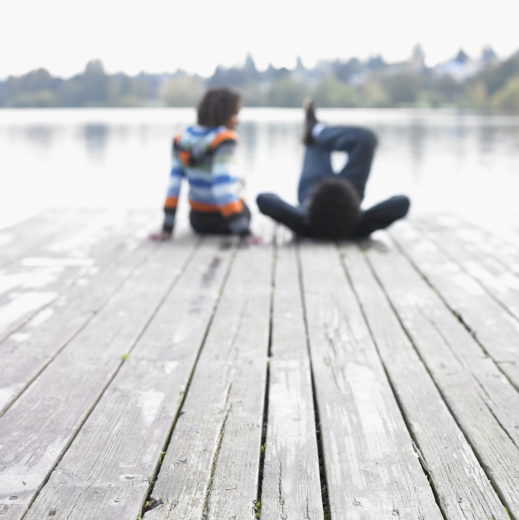 Blurred image of couple on dock